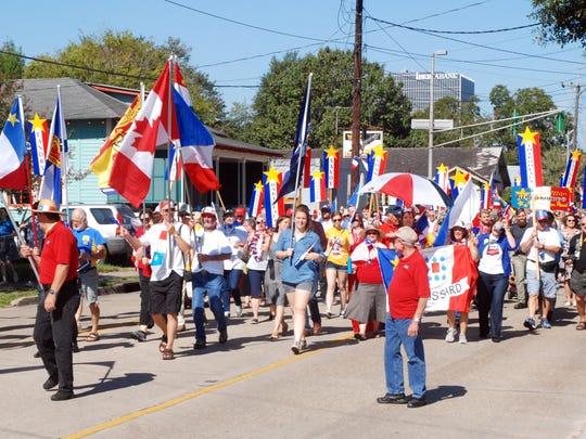 A Tintamarre procession heads down Garfield Street