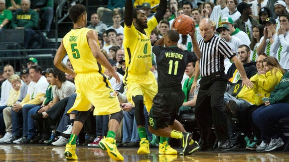 Nov 16, 2015; Eugene, OR, USA; Oregon Ducks forward Dwayne Benjamin (0) and guard Tyler Dorsey (5) put a half court defense against Baylor guard Lester Medford (11) during the first half at Matthew Knight Arena. Mandatory Credit: Troy Wayrynen-USA TODAY Sports