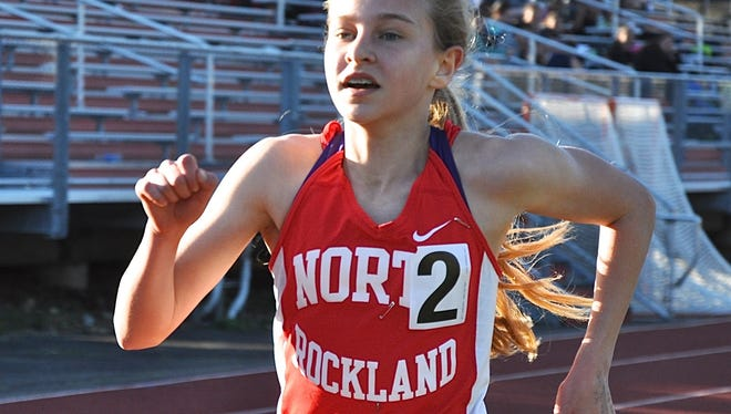 Katelyn Tuohy of North Rockland pushes for home, running a personal best to win the Red Raider Relay 3,200..