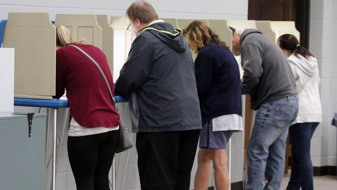 People fill the voting boots at Bethany Reformed Church Tuesday November 8, 2016 in Sheboygan.