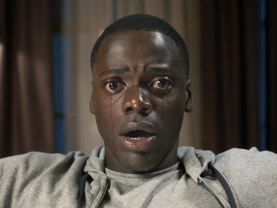 """Chris (Daniel Kaluuya) better heed the warning in the title """"Get Out."""""""