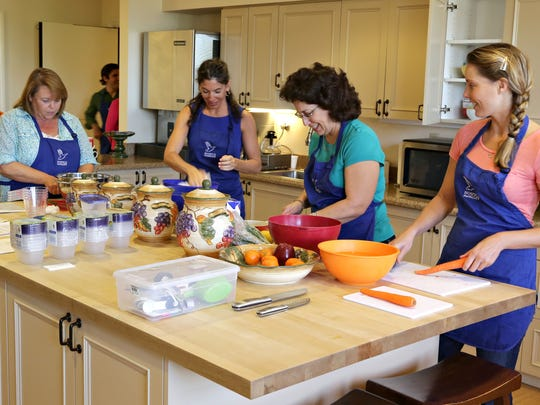 L-R, Sarah Frew, Laurie Motola, Susan Garcia and Nicole Lupica, chop and prepare veggies for soup. They are members of the Soup Troop, who makes soup for Hospice patients, as seen in Phoenix, on Sept. 23, 2014.