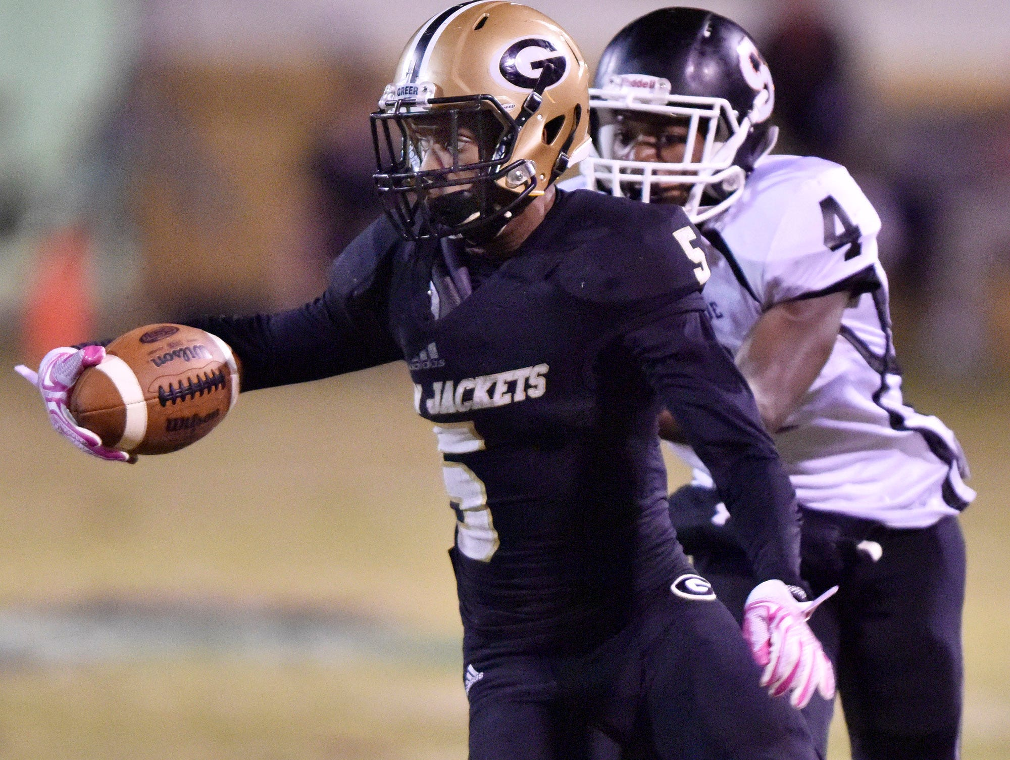 Greer's Troy Pride (5) is caught by Southside's Tyrone Talbert (4).