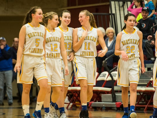 Northern Lebanon's, from left, Liz Voight, Amber Kintzer, Zoe Zerman, Megan Brandt and Zara Zerman celebrate after the Vikings routed Murrell Dobbins Tech 74-16 in the first round of the PIAA 4A state tournament on Friday night at Lebanon High.