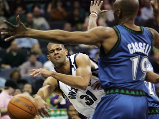 Memphis Grizzlies' Shane Battier makes a pass past the outstretched arm of Minnesota Timberwolves' Sam Cassell during the first quarter Tuesday, Feb. 8, 2005, in Memphis, Tenn. (AP Photo/A.J. Wolfe)