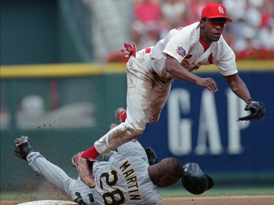 Delino DeShields tries to turn a double play for the Cardinals in 1997.