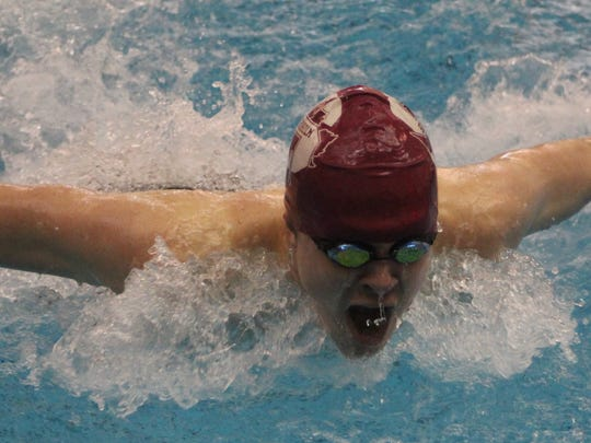 Seaholm junior Michael Arpasi floated to the 100-butterfly