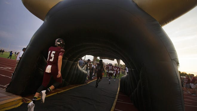 Red Mountain takes the field during a high school football game against Chandler in Mesa on August 19, 2016.