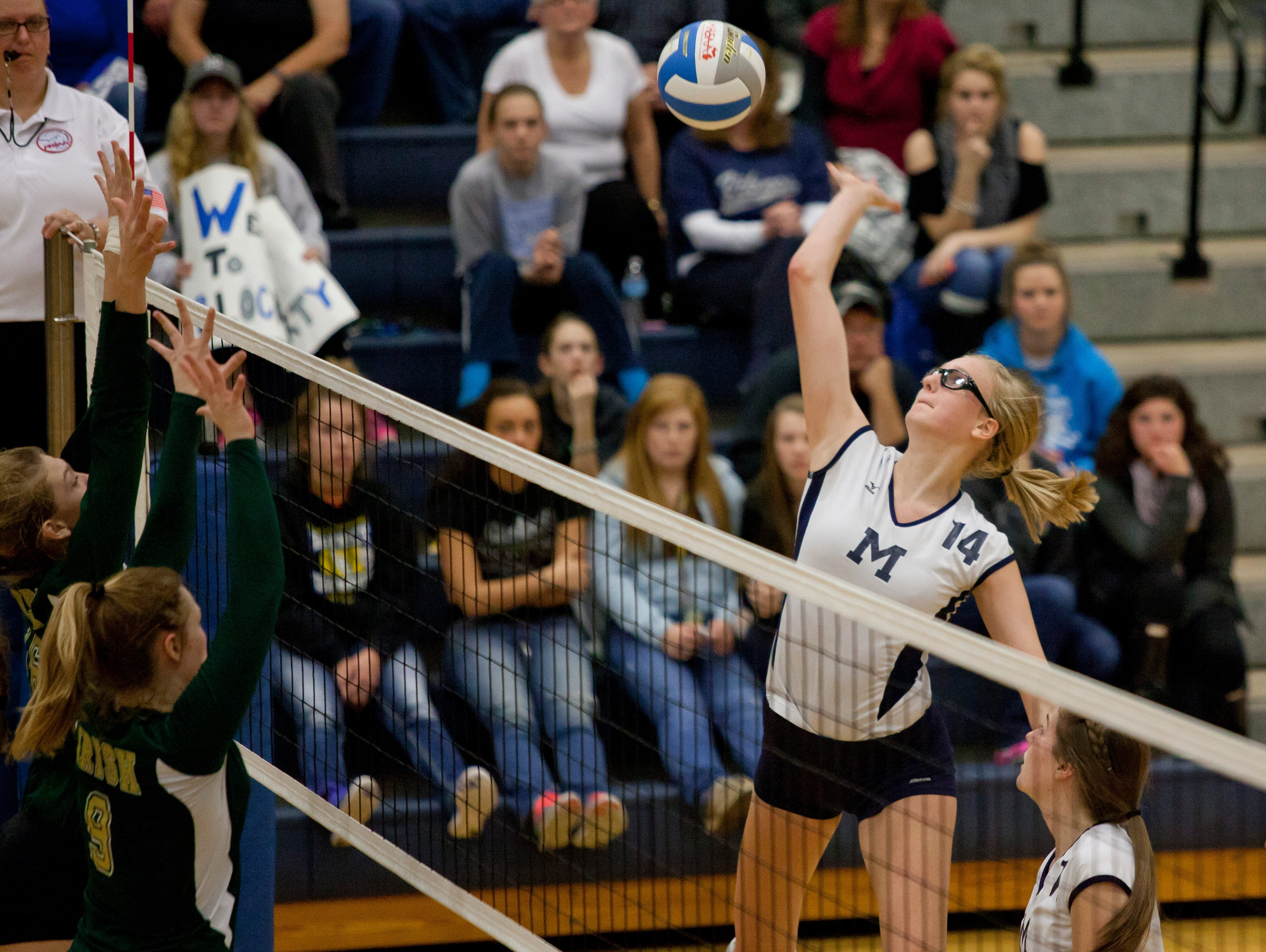 Marysville junior Payton Husson spikes the ball during a regional semifinal volleyball game Tuesday, November 10, 2015 at Imlay City High School.
