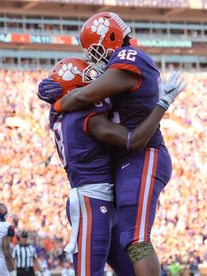 Clemson wide receiver Deon Cain (8) celebrates with defensive lineman Christian Wilkins (42) after scoring against Syracuse last Saturday at Clemson's Memorial Stadium.