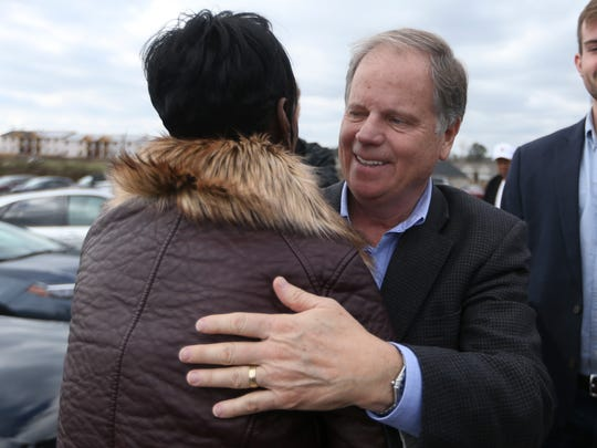 Democrat Doug Jones greets supporters and voters outside