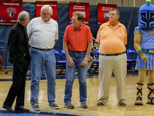Members of the first UWF men's basketball team, from