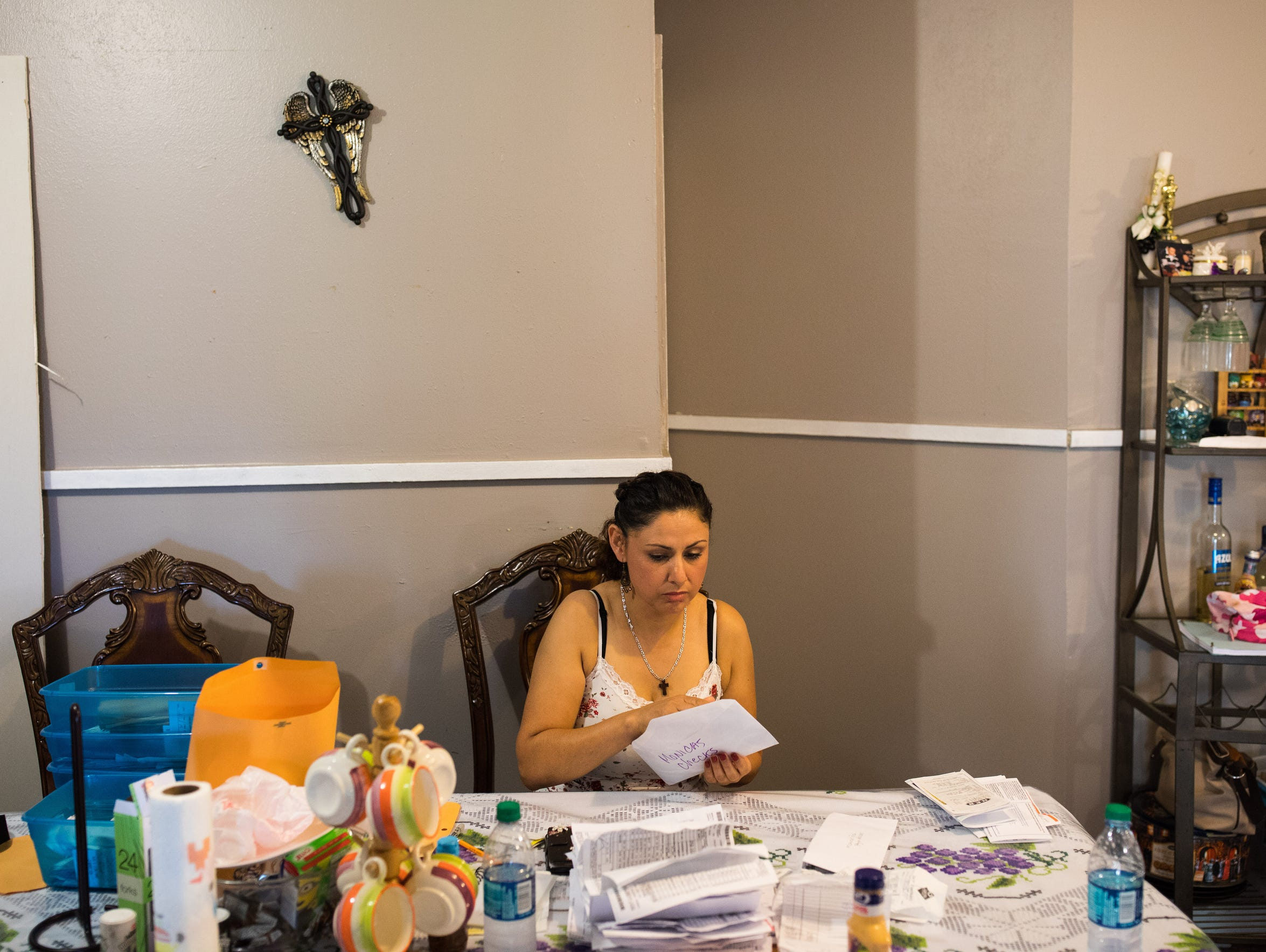 Monica Rocha Alcarez goes through receipts as she prepares her taxes for her restaurant on Oct. 13, 2017. She was brought over from Mexico at the age of four. She's earned a business degree and since becoming a DACA recipient she's been able to become a business owner.