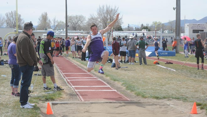Yerington's Josiah Rizenstein competes in the long jump at the Relays.