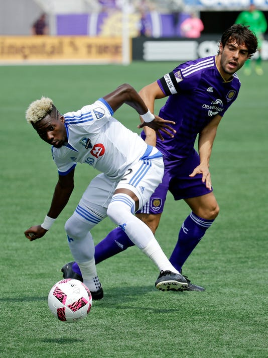 Montreal Impact's Ambroise Oyongo, left, moves to get possession of the ball from Orlando City's Kaka during the first half of an MLS soccer game, Sunday, Oct. 2, 2016, in Orlando, Fla. (AP Photo/John Raoux)
