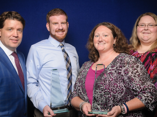 Because of their service and dedication, Sara Shular (right) and members of her team (Adam Davis and Alison Fox, center) were awarded the BlueCross Pinnacle Peace of Mind Award in June 2017. Pictured at left is BlueCross CEO JD Hickey, M.D.