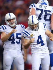 Indianapolis Colts kicker Adam Vinatieri (4) reacts after kicking the game-winner on Sunday in Atlanta.