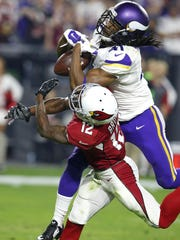The Minnesota Vikings' Anthony Harris breaks up a pass intended for Arizona Cardinals wide receiver John Brown (12) during the second half on Dec. 10 in Glendale, Arizona.