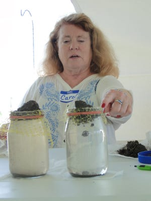 Carol Schutte, coordinator of the Women, Food and Ag Network, Women Caring for the Land, demonstrated water run-off on different types of soils.