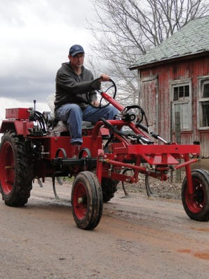 John Hendrickson tries out the  Oggún tractor at his farm in Reeseville on April 4. Hendrickson also works for the University of Wisconsin's Center for Integrated Agricultural Studies and hosted a farm meeting for young producers earlier in the day.