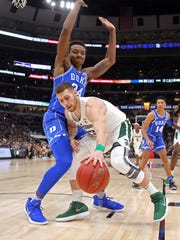 Michigan State Spartans forward Ben Carter (13) fights