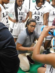 Northwest High girls basketball coach Nicole Manuel speaks to her team during a timeout at the St. Landry Parish Basketball Tournament last week. Northwest, now 12-1, defeated Eunice High on Tuesday night to open District 5-3A.