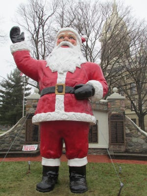 This giant Santa Claus stands next to the Ingham County Courthouse in downtown Mason.