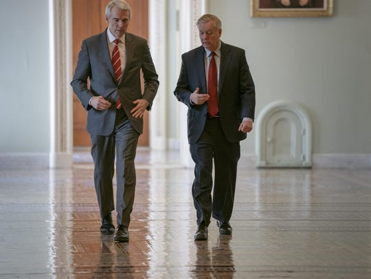 Sen. Rob Portman, R-Ohio, left, and Senate Judiciary