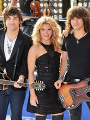 "The Band Perry -- Neil Perry (from left), Kimberly Perry and Reid Perry -- shown performing on NBC's 'Today"" in 2013, will perform as part of the Brickyard Music Festival Saturday."