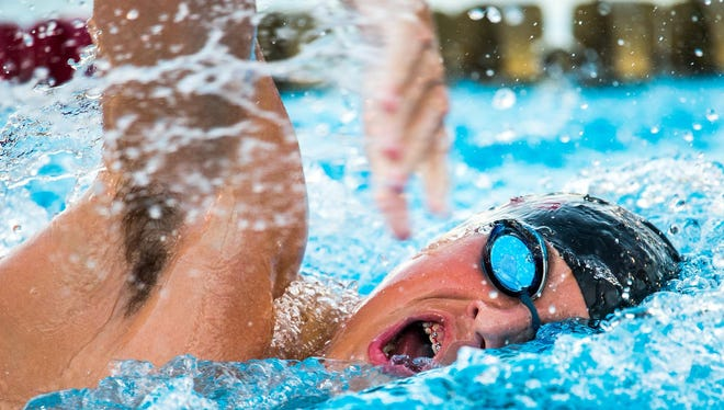 Chiles' Andrew Thrasher swims a leg of the 400 Freestyle Relay during Wednesday's meet against Pensacola Washington at Morcom Aquatic Center.