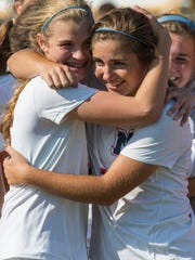 Terre Haute North players happily embrace each other after winning the regional game against Memorial on Saturday afternoon.