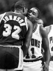 Pistons point guard Isiah Thomas, right, and the Los