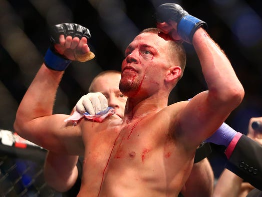 Nate Diaz celebrates his victory by submission against