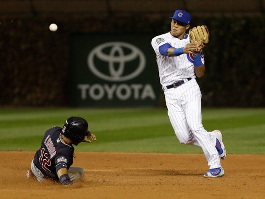 Cleveland Indians' Francisco Lindor is out at second as Chicago Cubs' Addison Russell turns a double play on a ball hit by Jose Ramirez during the third inning of Game 4 of the Major League Baseball World Series Saturday, Oct. 29, 2016, in Chicago. (AP Photo/David J. Phillip)