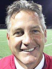 Grand Blanc coach Clint Alexander won in his return