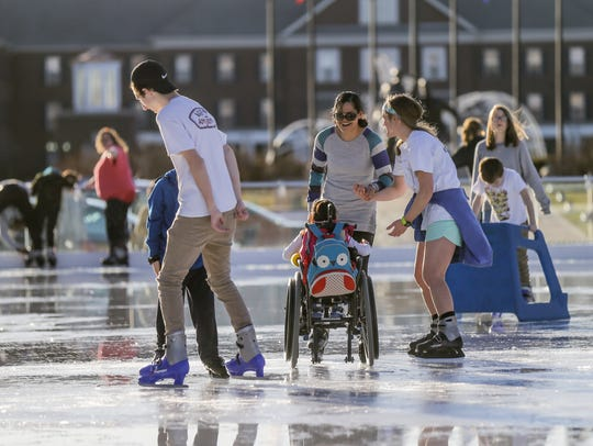 Special needs guests, family, and caretakers skate