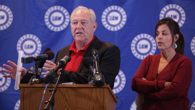 UAW President Dennis Williams speaks and Vice President Cindy Estrada listens Wednesday, Oct. 28, 2015, at the UAW-GM Center for Human Resources in Detroit. Details of the detail with GM were released. Voting will take place over the next couple of weeks.