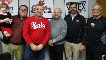 From left to right: Olivia Cox, Eric Cox, Joel Webb, Cincinnati Reds General Manager Walt Jocketty, Cincinnati Reds Chief Operating Officer Phil Castellini and Rich Delaney pose for a photo Thursday morning at the WBEX Radio Station building in downtown Chillicothe.