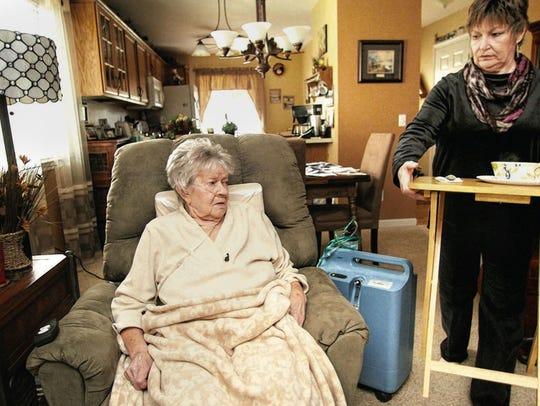 Kathy Pugh tends to her mother, fungal meningitis patient