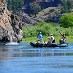 Anglers fly fish the Missouri River below Craig.