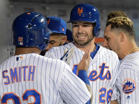 New York Mets' Kevin Plawecki (26) celebrates with Dominic Smith after Plawecki hit a two-run home run scoring Smith during the second inning of a baseball game against the Cincinnati Reds Saturday, Sept. 9, 2017, in New York.