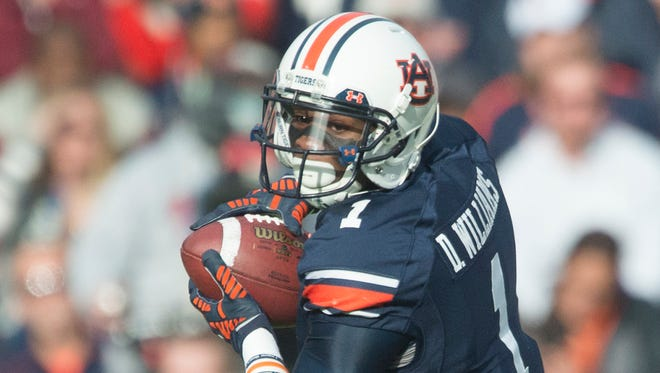 Auburn wide receiver D'haquille Williams is suspended for the Outback Bowl but intends to return for the 2015 season.