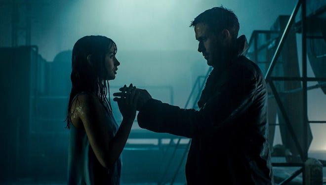 "Lovebirds Joi (Ana de Armas, left) and K (Ryan Gosling) share a moment in the sequel ""Blade Runner 2049."""