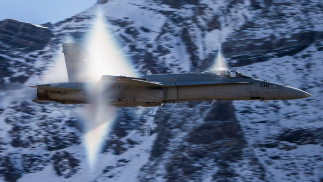A Swiss Air Force F/A-18 Hornet fighter jet performs a high-speed flyby breaking the sonic barrier as pilots demonstrate their skills in the Swiss Alps above Axalp Ebenfluh on Tuesday, Oct. 10, 2017. At an altitude of 2,200 meters (7,200 feet) above sea level, spectators watched the performances at the highest air force firing range in Europe.