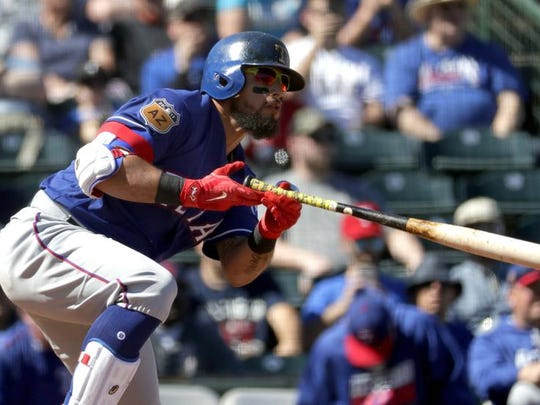 Texas second baseman Rougned Odor follows through on a base hit against the Angels during a spring training game. Odor and the Texas Rangers have agreed to a new six-year contract that includes a club option for 2023.