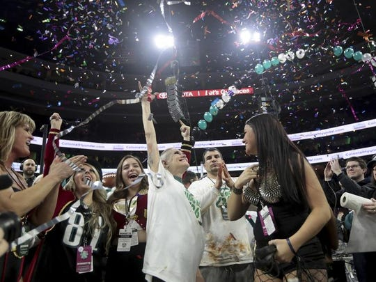Molly Schuyler celebrates her victory in WIP's Wing Bowl 26 at the Wells Fargo Center in Philadelphia, Friday, Feb. 2, 2018.
