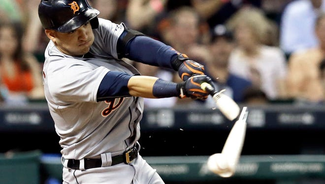 Tigers shortstop Jose Iglesias breaks his bat on a double during the fifth inning of the Tigers' 5-1 loss Friday in Houston.