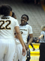 Southern Miss senior Brittanny Dinkins smiles during Thursday's home win over Old Dominion.