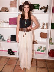 Actress Hayley Orrantia wears a maxi skirt at the JustFab