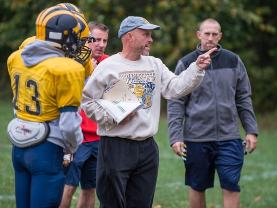 Climax-Scotts's head football coach Kevin Langs works